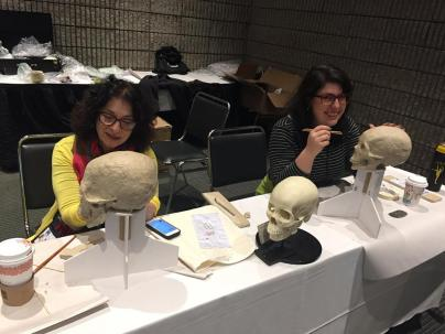Thanks to Karen for evidence that I can not stop smiling around skulls and clay.